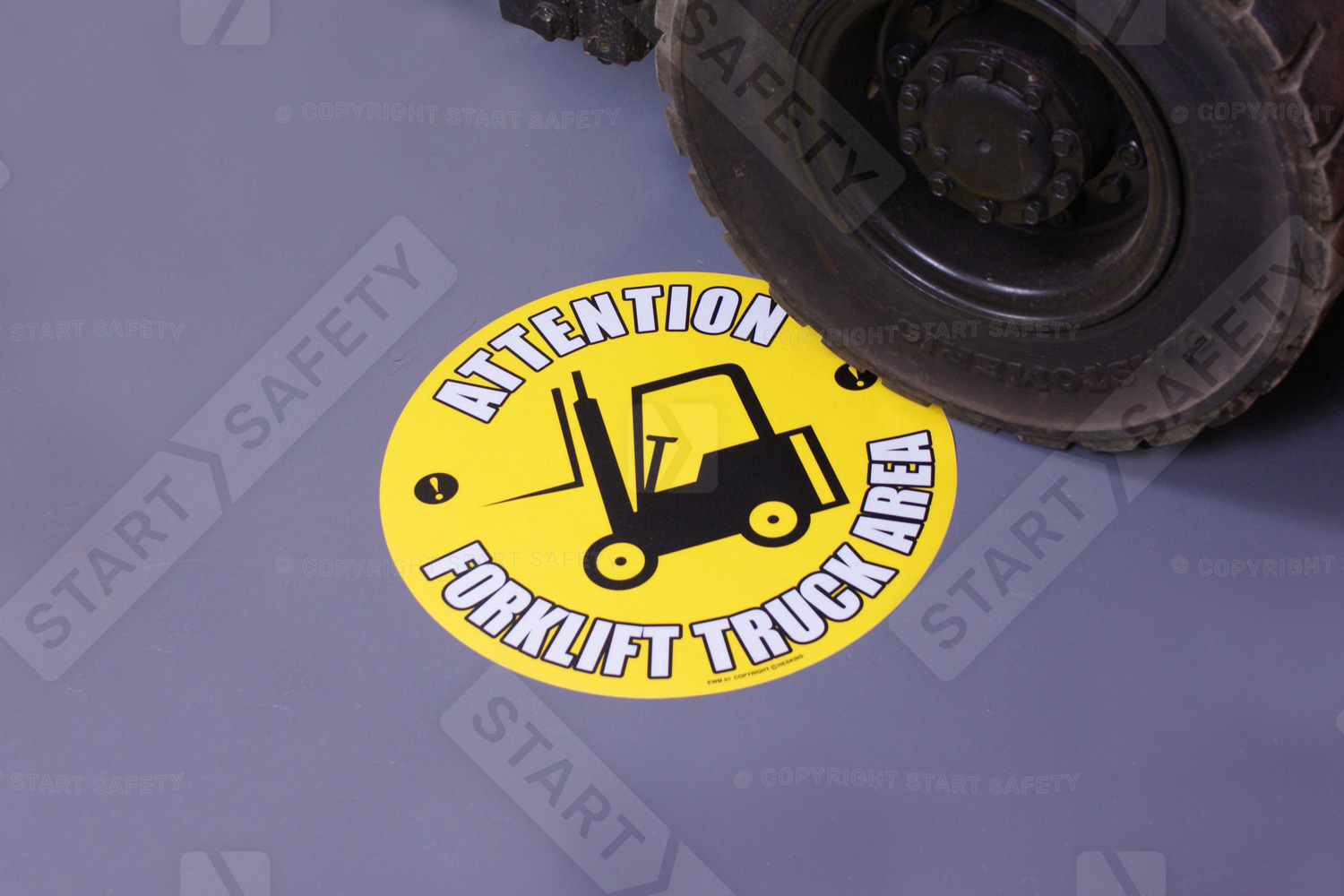 Floor sticker being ran over with a forklift
