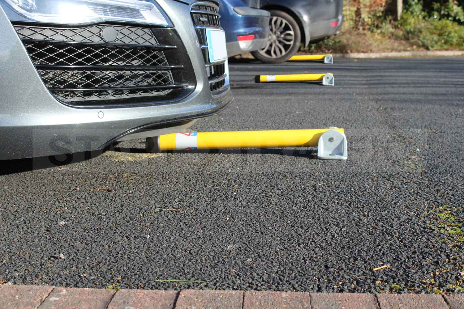 Hinged Parking posts reserving private spaces