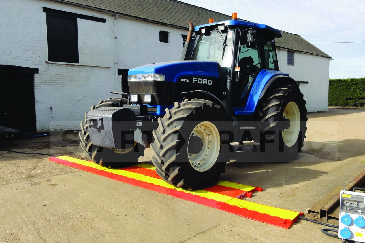 Tractor Crossing Checkers Cable Ramps