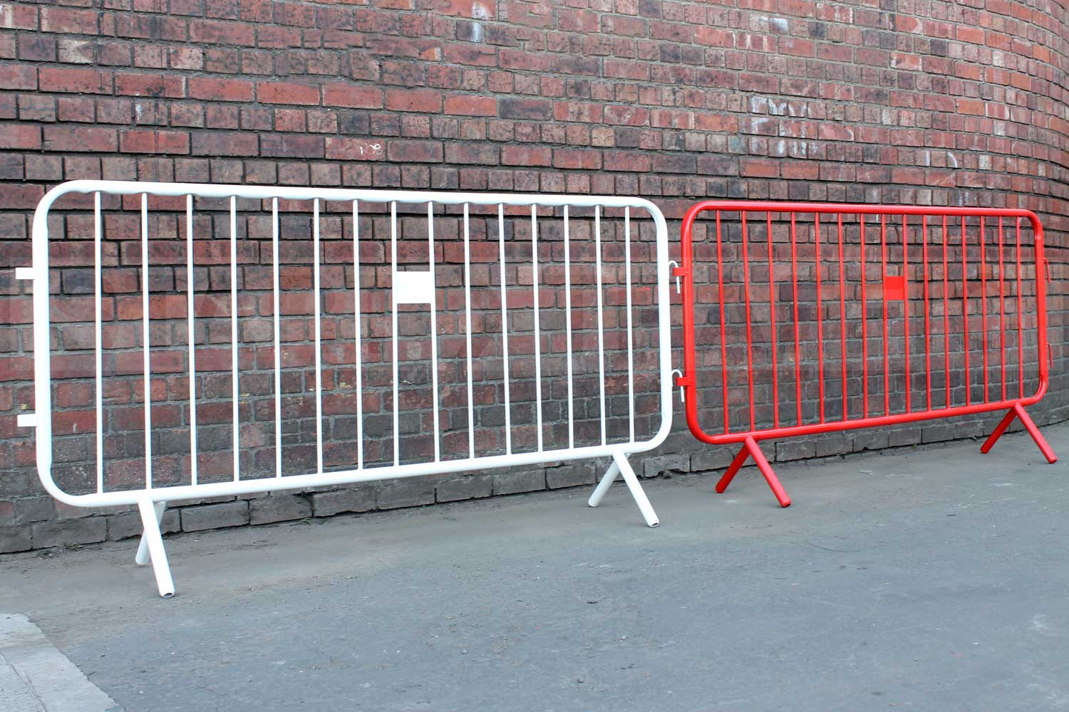image of red and white fixed leg crowd barriers