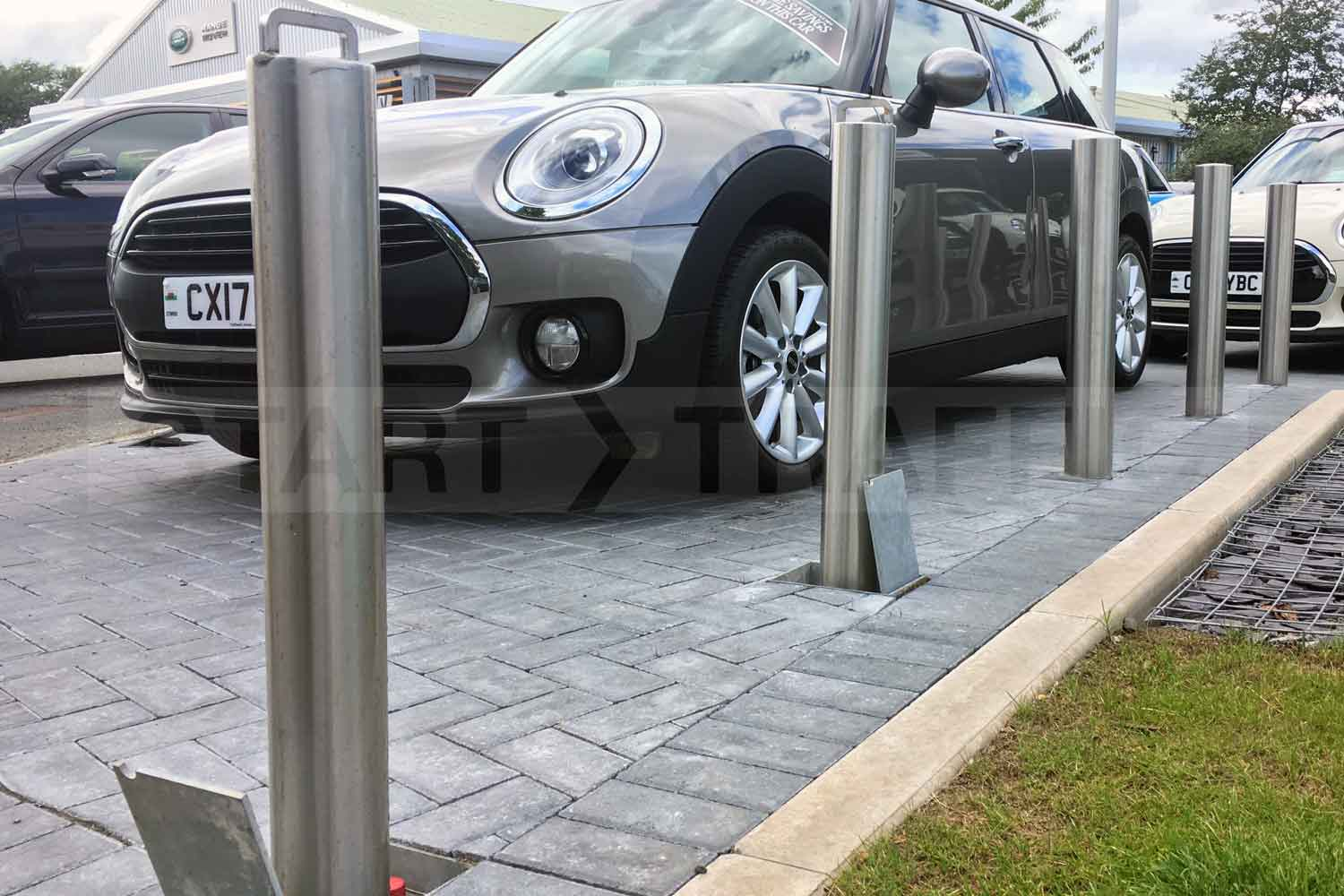 retractable Stainless Parking Post installed at a car showroom