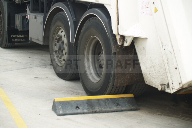 Truckstop Against Rear of Tyre Close Up